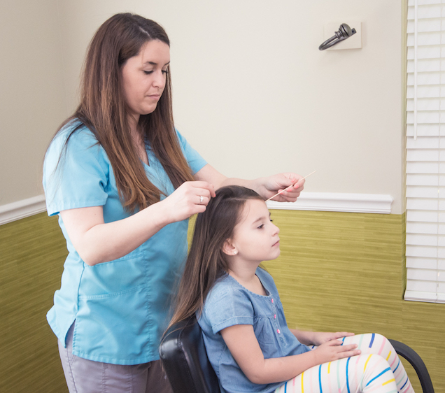One of our trained medical professionals treating a patient with lice